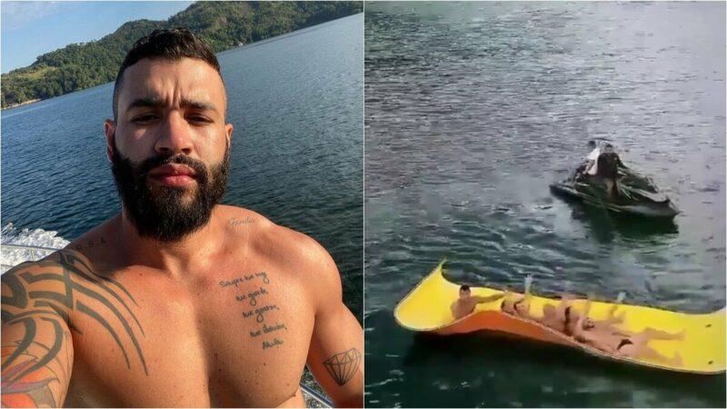 Gusttavo Lima filma os fãs cantando a música, 'Rosas, versos e vinhos', no mar em Angra dos Reis